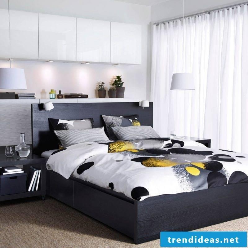 Ikea Besta shelf for a bedroom in black and white design