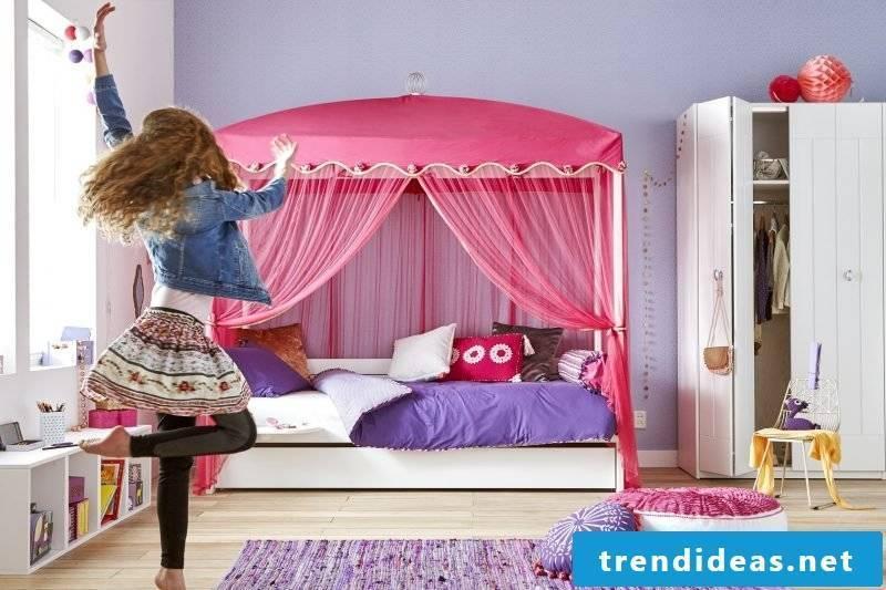 Four-poster curtain nursery