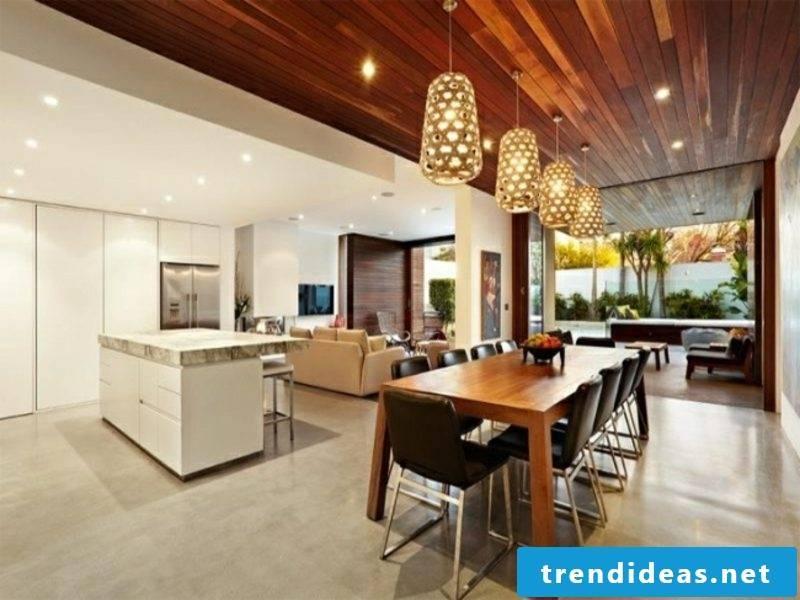 open kitchen with living room golden pendant lights