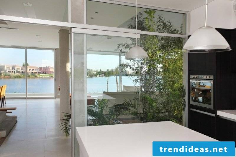 beautiful kitchen separated from the living room glass door