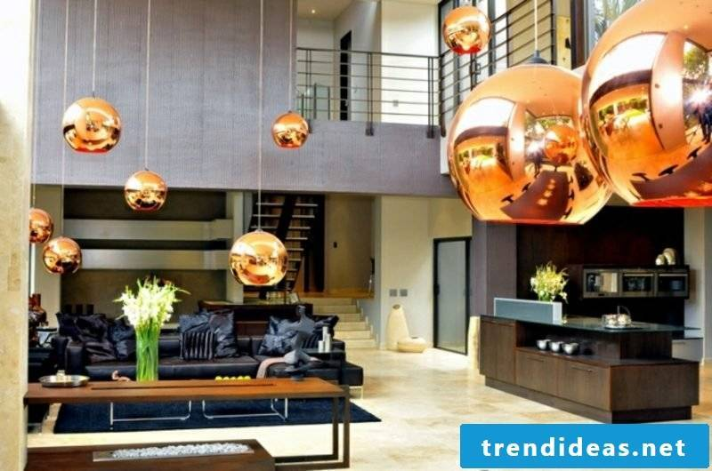 Living room with open kitchen copper pendant lights