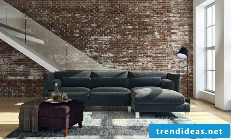 Living room frame long sofa gray upholstery brick wall