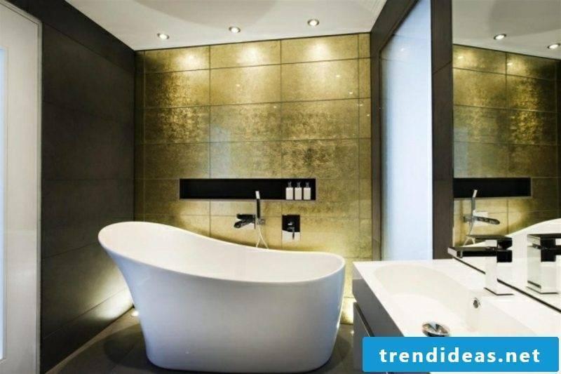 Luxury bathroom large porcelain sink golden wall tiles accent lighting