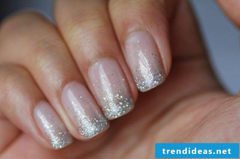 Nails themselves make French with sparkles elegant look