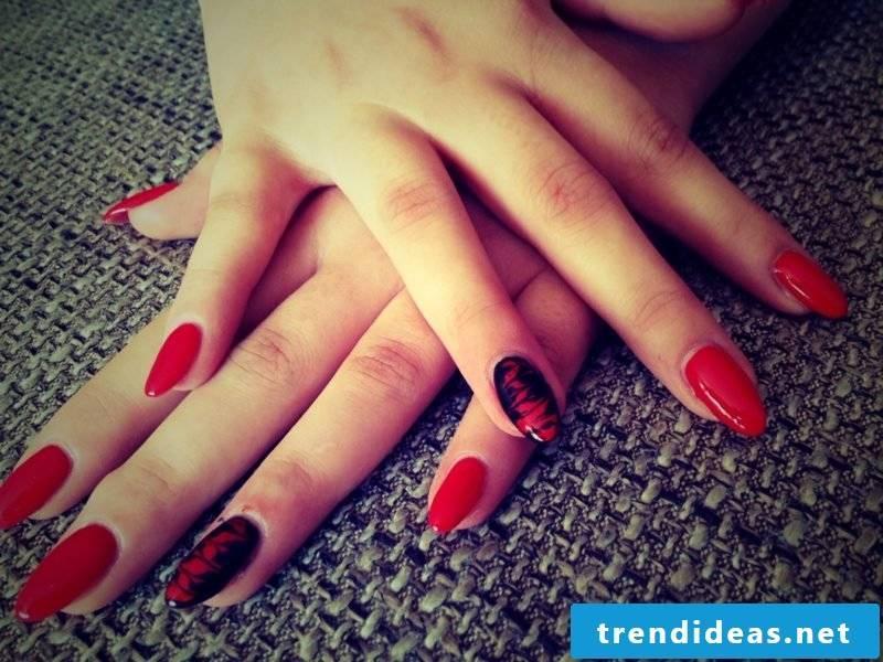 Gel nails in red original decoration
