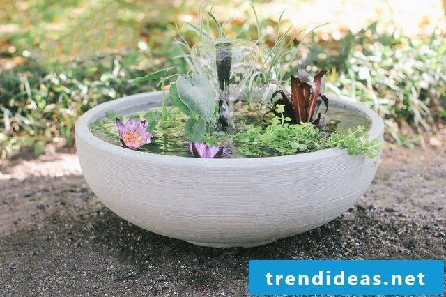 Great ideas for balcony design - DIY mini fountain in the pot