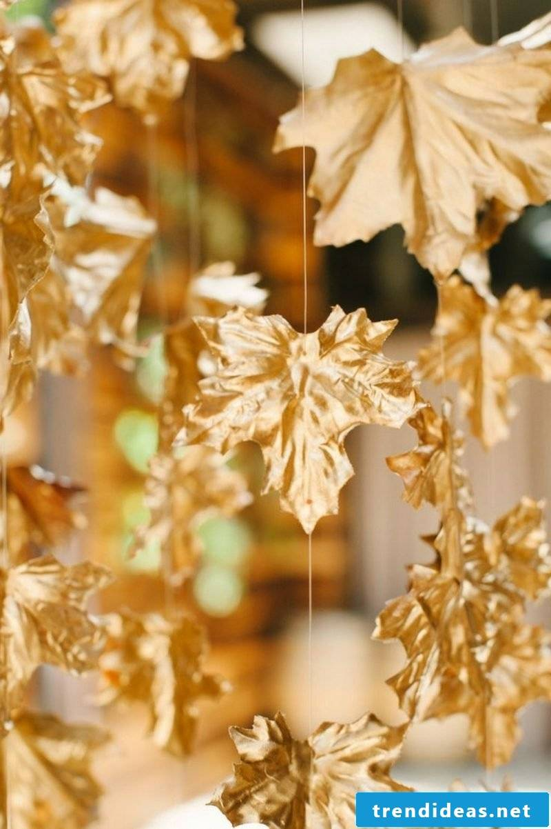 Autumn decoration with leaves colored golden