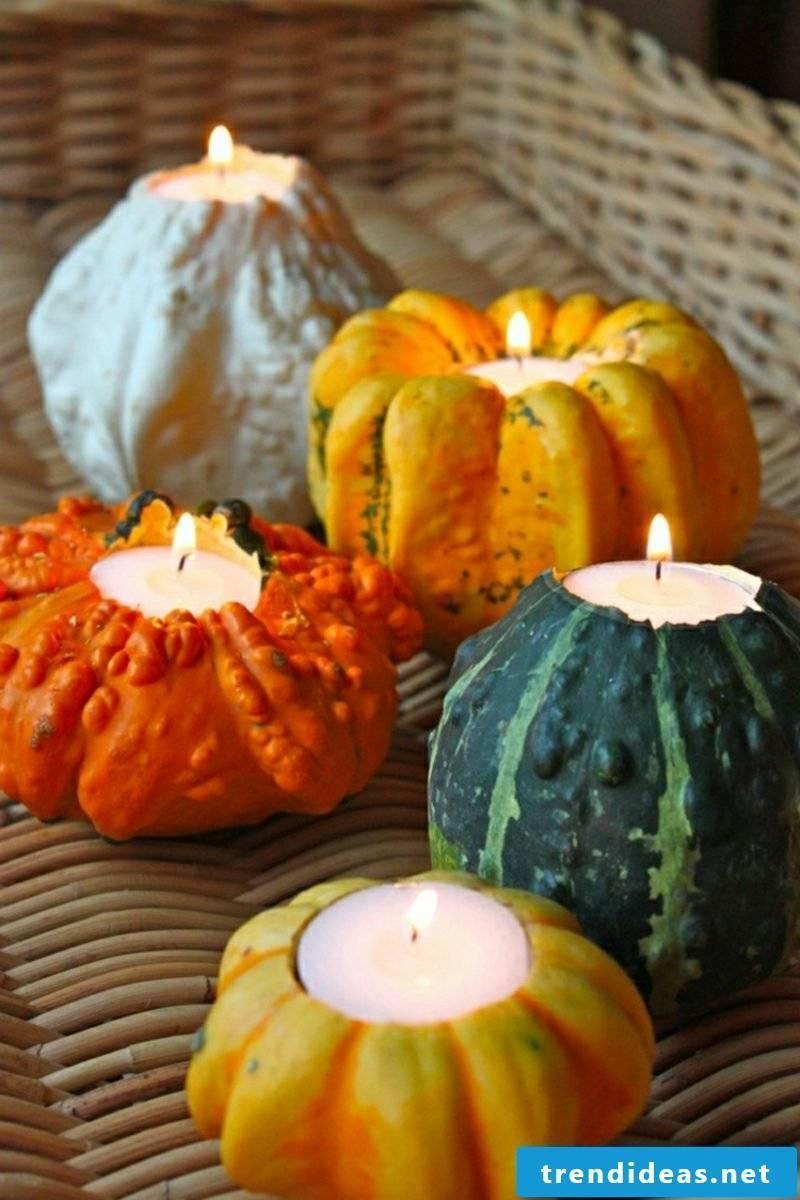 Autumn decoration pumpkins as a candle holder