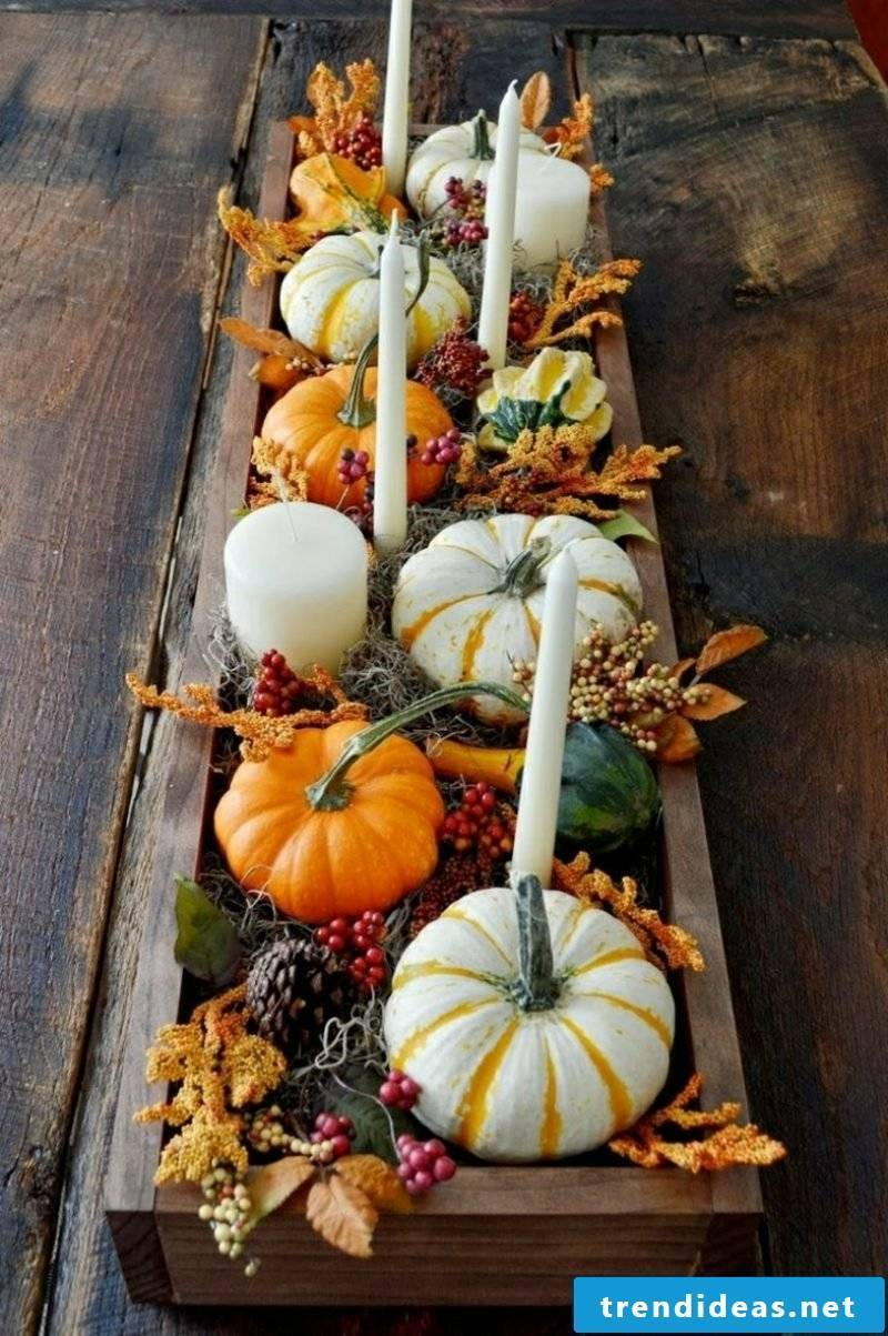 Autumn decoration table candles and pumpkins