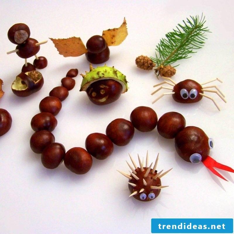 Tinker with children Autumn snake chestnuts