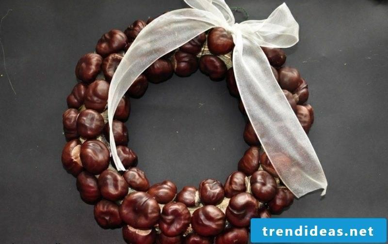 Autumn tinker with children's chestnut wreath