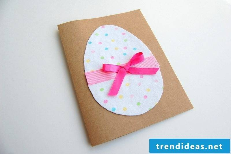 Easter cards on hard paper with an egg on the front and pink ribbons