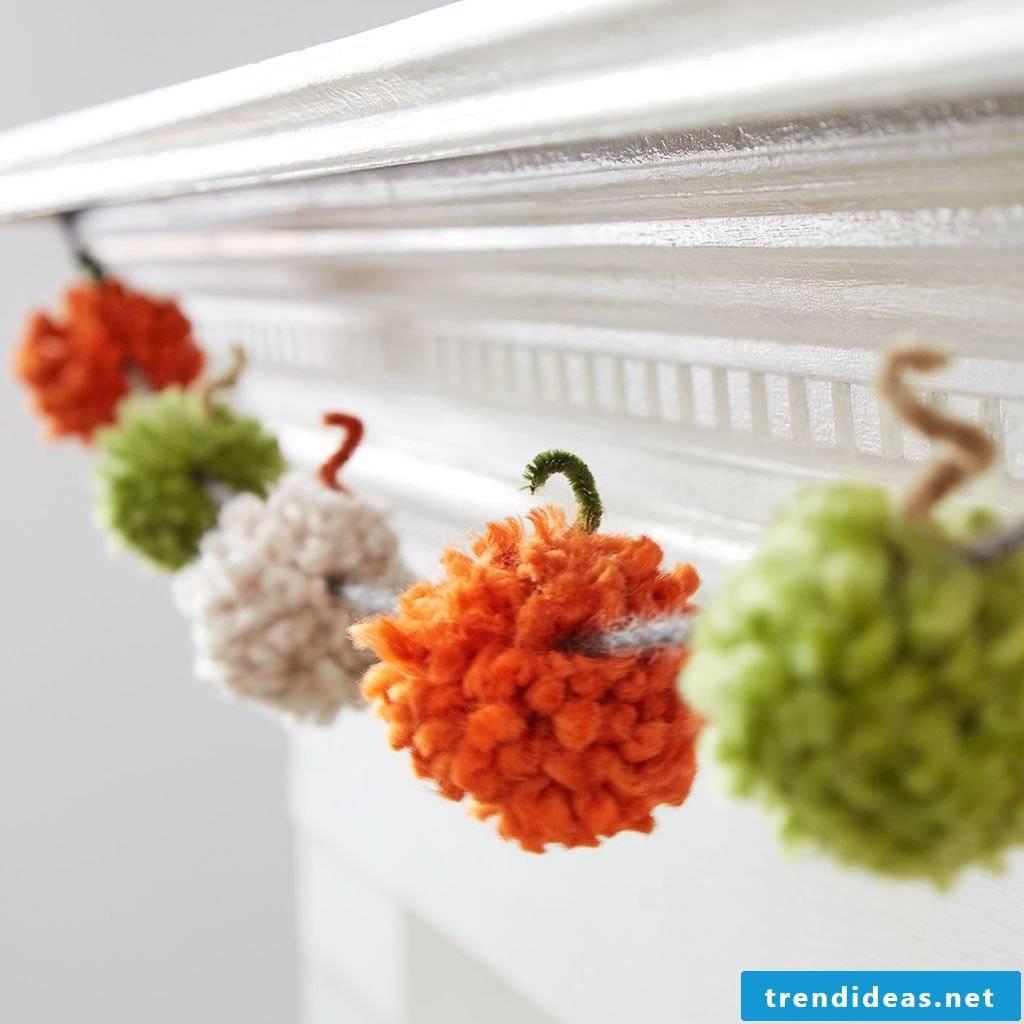 Autumn decoration made of pompom pumpkins