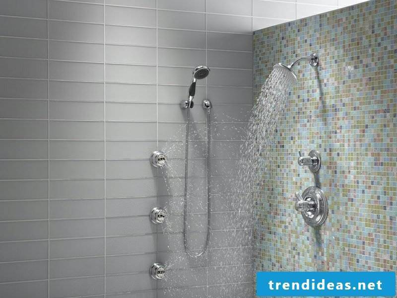 Bathroom with brick shower and original mosaic tiles