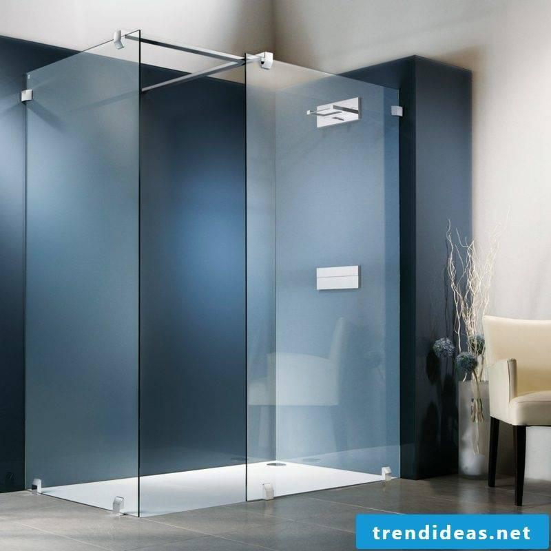brick shower and modern glass shower cabin