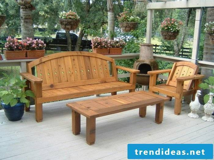 massive-garden furniture-garden furniture-set-wood-bench-table-chair-Gartendeko-plant