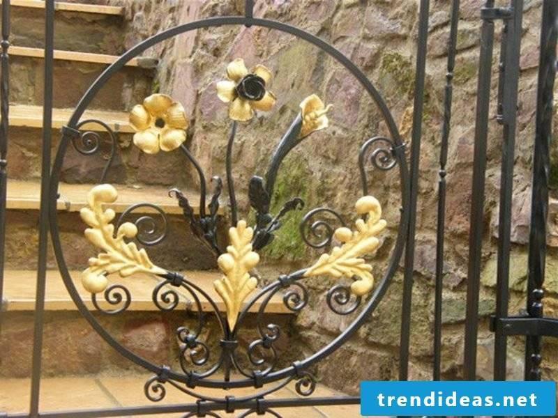 Metal garden gates beautiful flowers leaves bronze