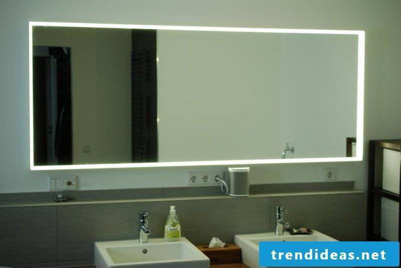 large bathroom mirror with integrated lighting