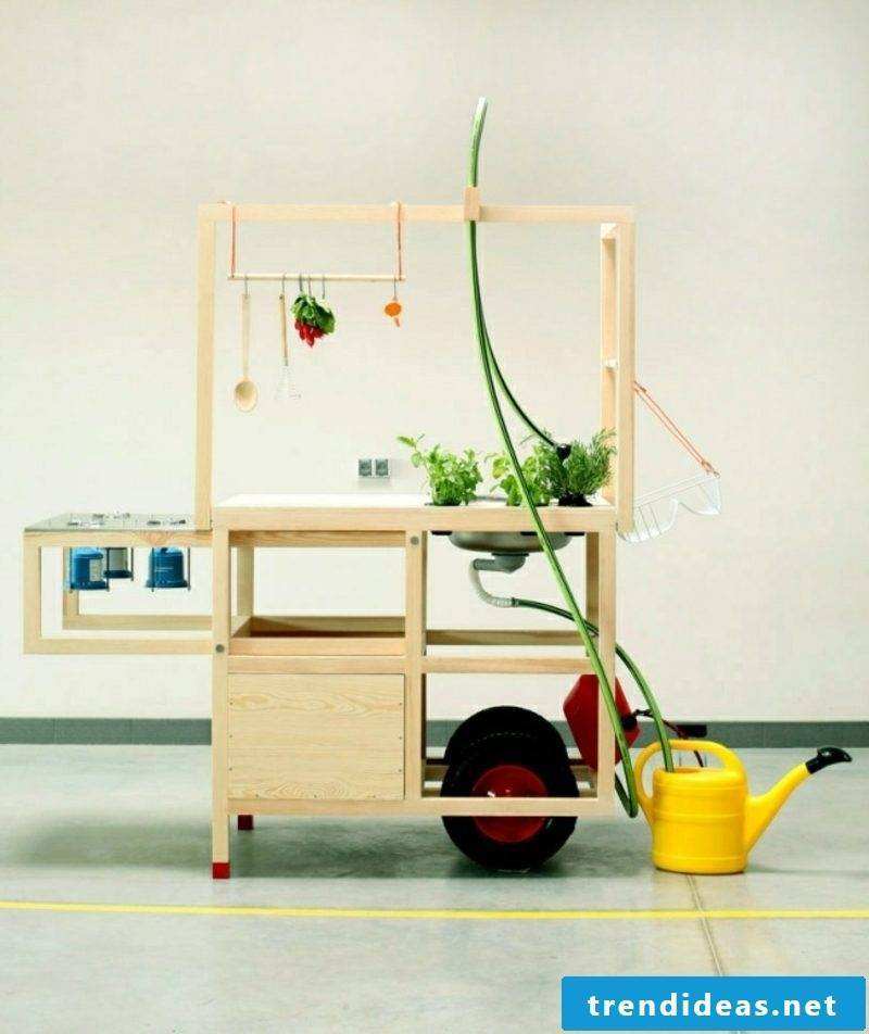 modern mobile kitchen in solid wood and stainless steel