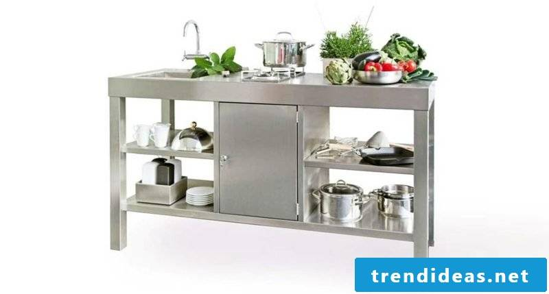 modern mobile kitchen in stainless steel with sink, shelves and gas cooker