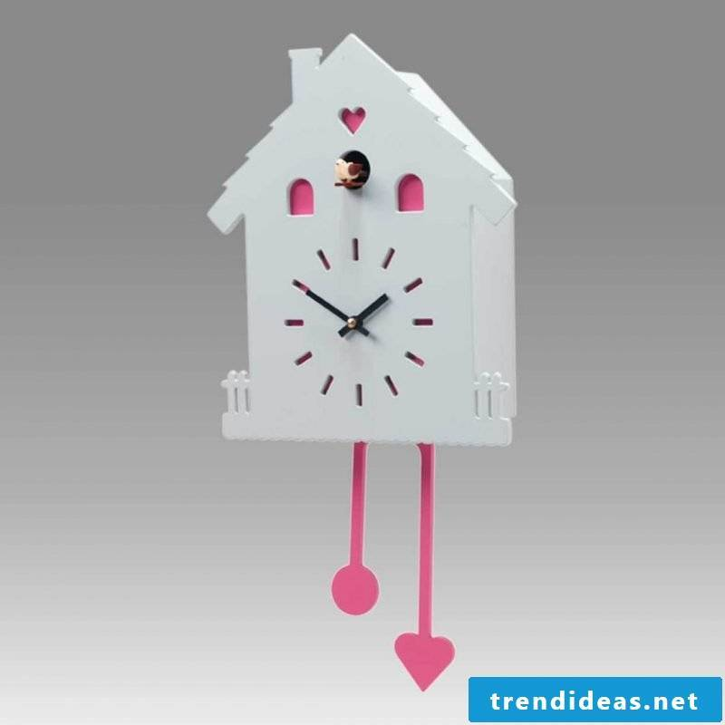 Cuckoo clock in white and pink.