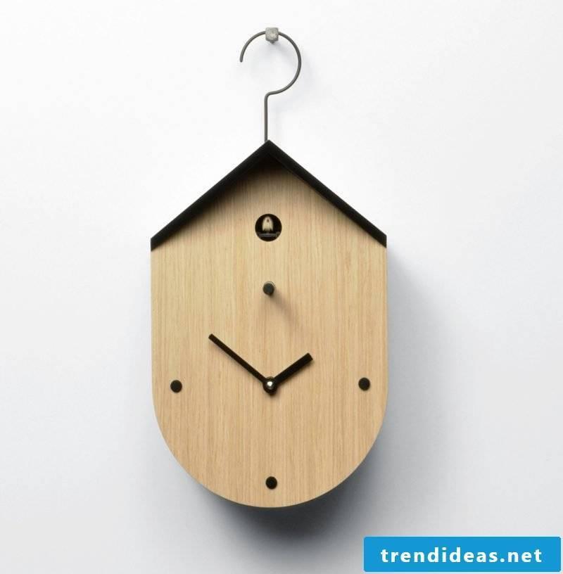 Modern cuckoo clock hanging on the wall.