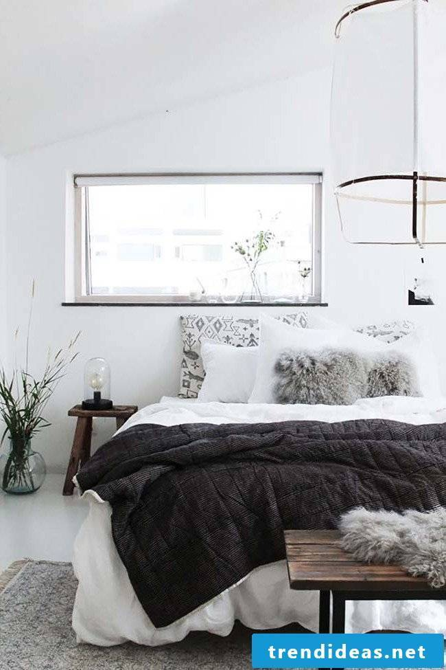 Cuddly blankets in the bedroom create a cozy atmosphere