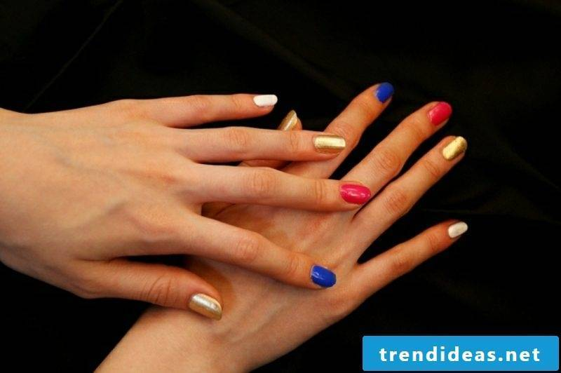 interesting nail art design blue, gold and red