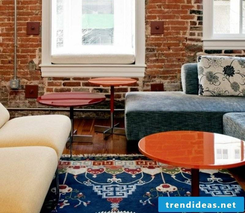 Oriental rug in blue nuances Living room accent wall of brick