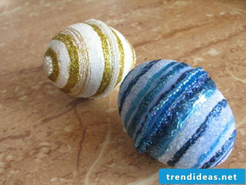 Easter eggs painted with kids yarn glitter colors