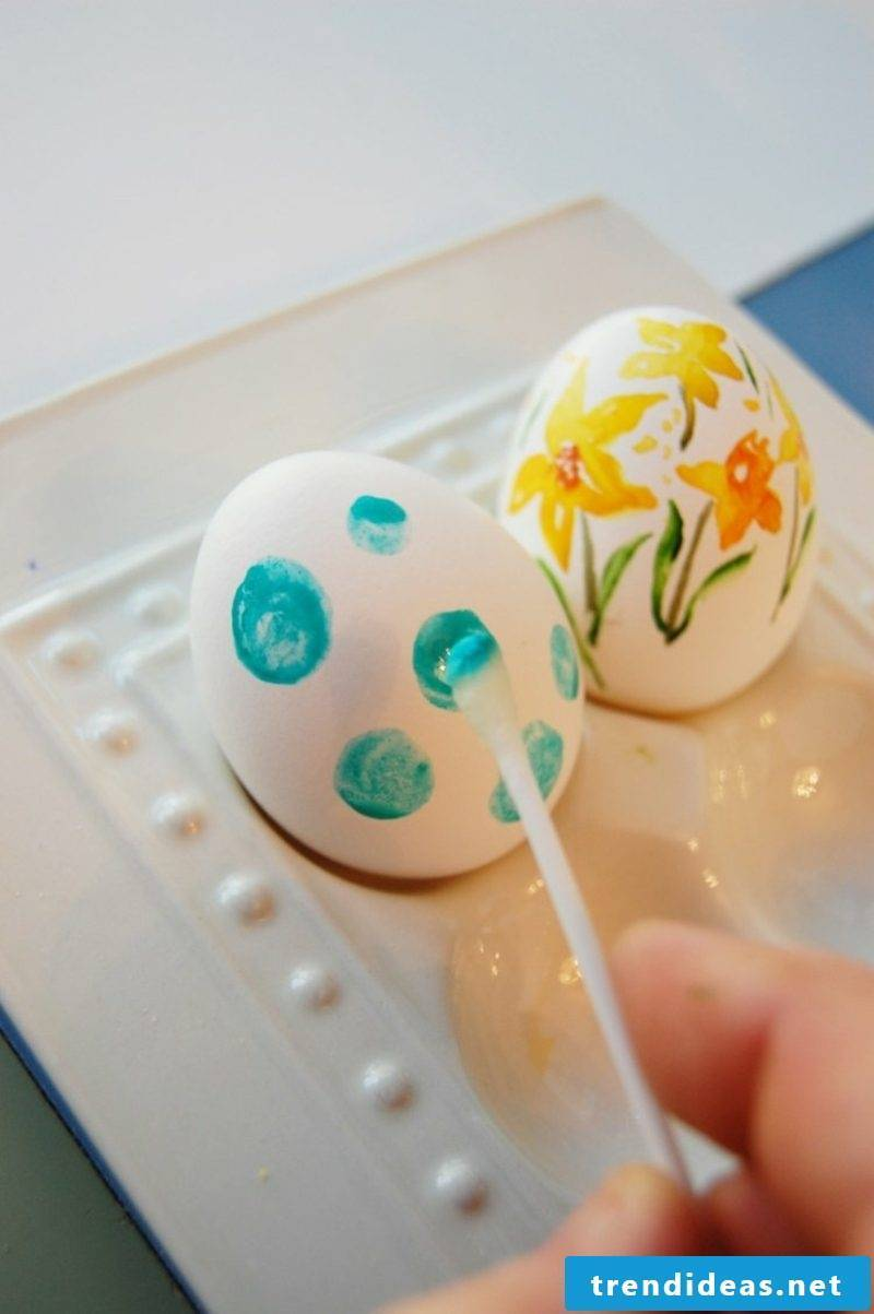 Easter eggs painted with children's watercolor dots pattern