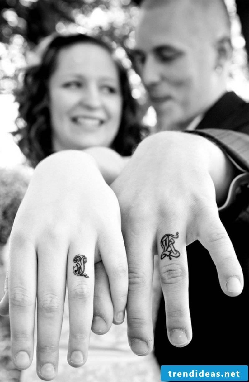 Partner tattoos initial instead of wedding rings