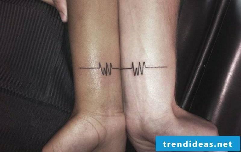 Partner tattoos pulse heart diagram