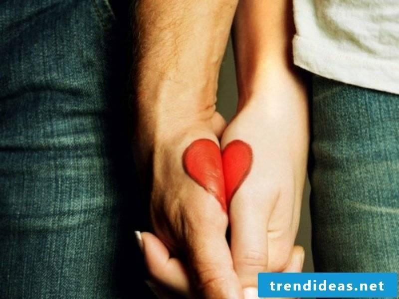 Partner tattoos heart symbol of love