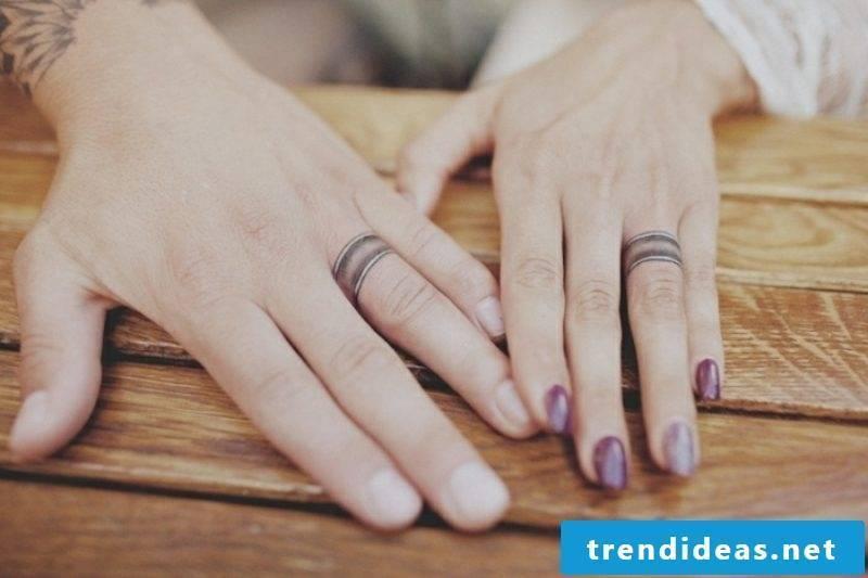 Partner tattoos wedding rings