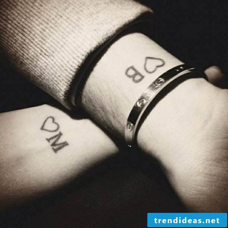 Partner Tattoos Initial and Hearts