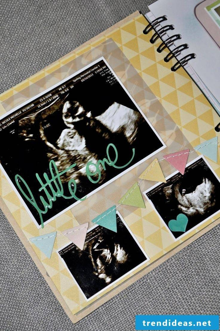 Baby photo album at the beginning of life with ultrasound pictures