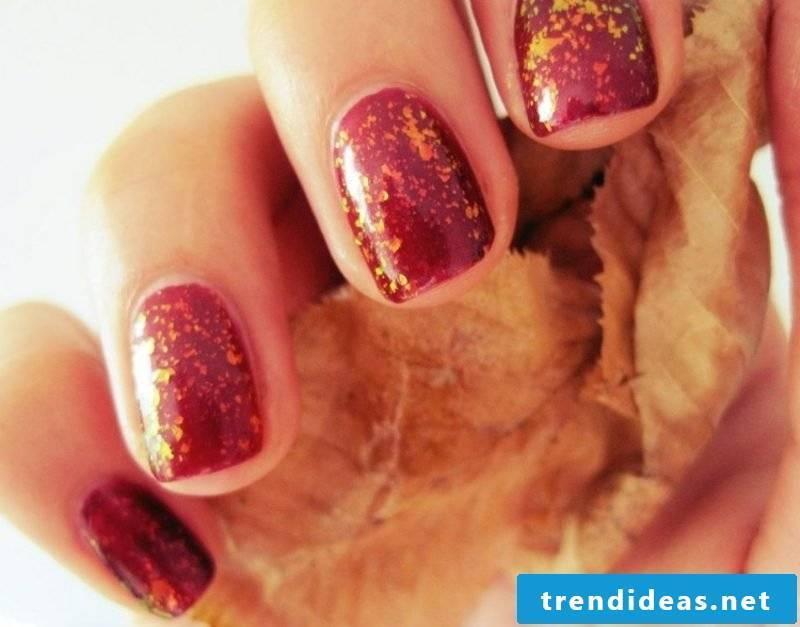 Nail polish in red golden glitter