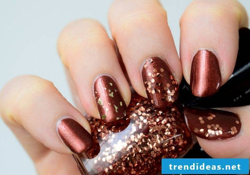 Nail polish Dark red golden glitter particles