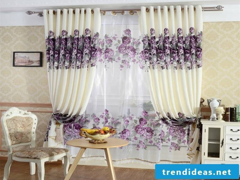purple window curtains with floral decoration