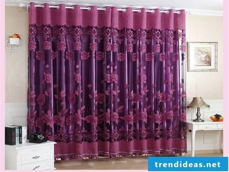 purple roses on the purple window curtains