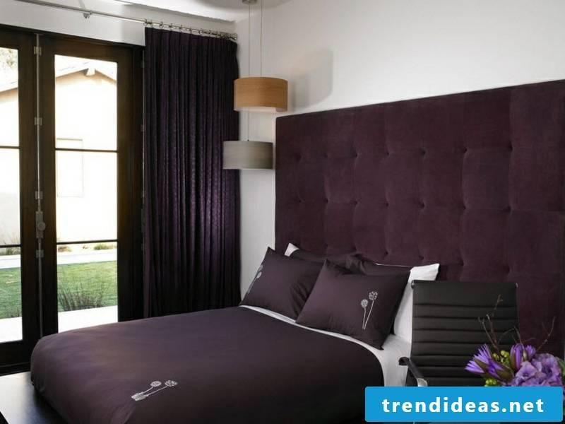 designer stylish bedroom with purple window curtains