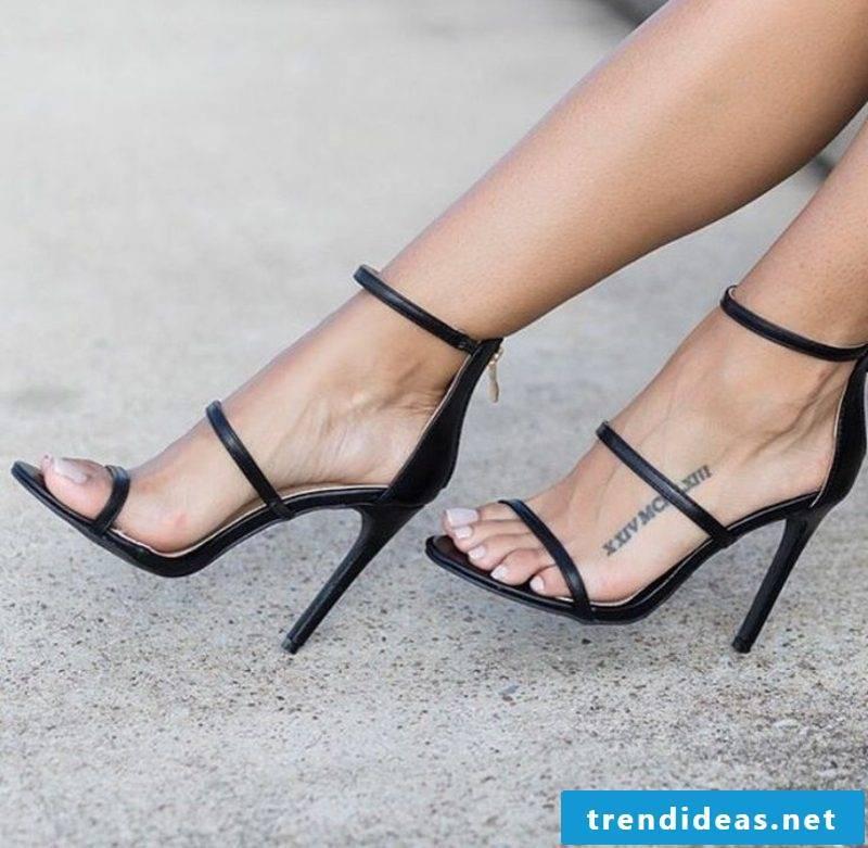 Roman numerals tattoo foot elegant look