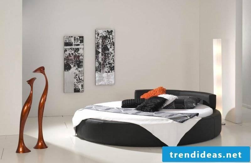 round bed in black bedroom minimalist