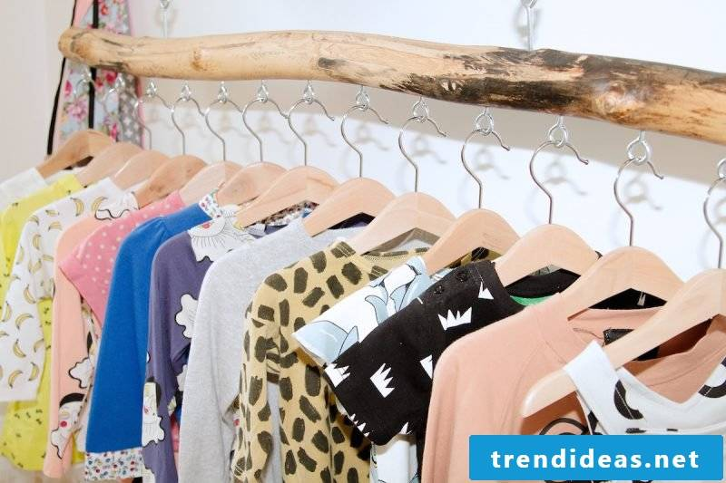 Clothes rail for the wall made of natural wood