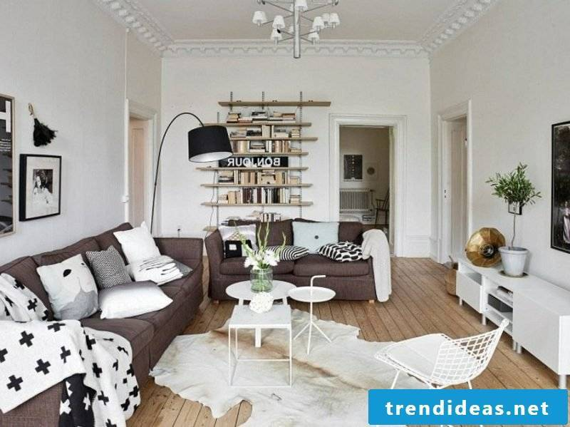 Scandinavian furniture living room two brown sofa beds open shelving interesting lamp in stainless steel