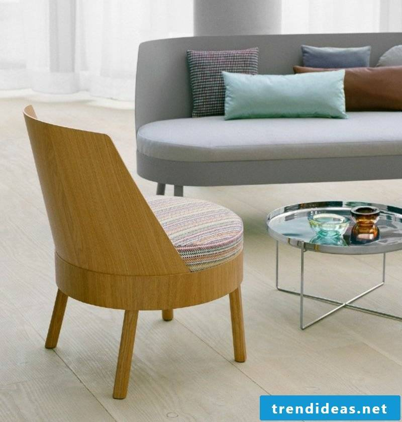 Scandinavian furniture soft upholstered sofa in gray and original solid wood chair