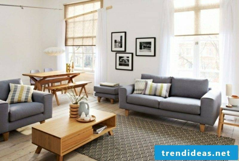 scandinavian furniture living room gray sofa rug with geometric motifs coffee table in solid wood
