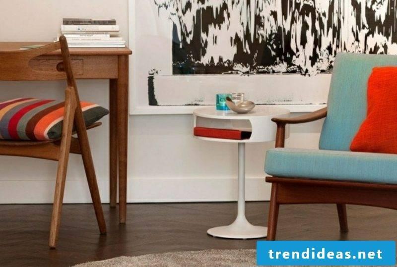Scandinavian furniture armchair light blue upholstery white table wood floor