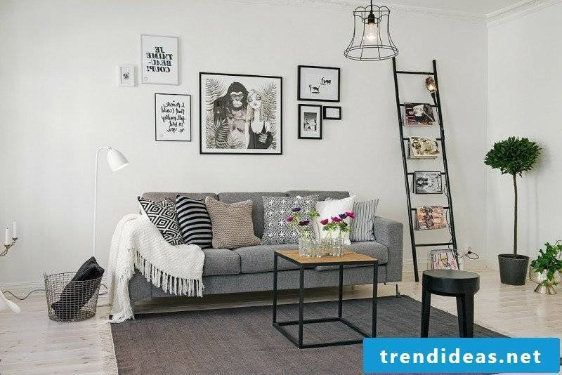 Scandinavian furniture living room original carpet gray upholstered sofa interesting photos and pictures on the wall